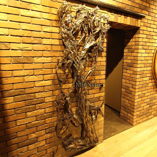 Drzwi szklane z kutym drzewem metaloplastyka